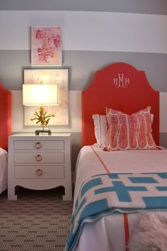 twin beds with monogrammed headboards in a little boys' room