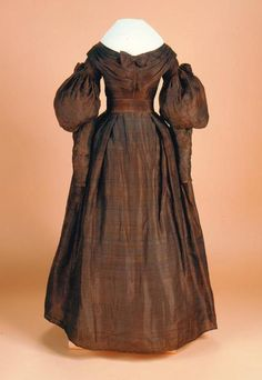 Dress: ca. 1836, cotton/silk changeable fabric, armscye and sleeve seams are piped, the skirt and sleeves are lined with loosely woven cotton, the bodice is lined with glazed cotton.  Object Number: 2001.49.9