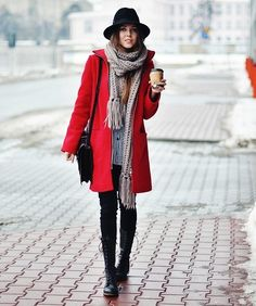 chunky scarf, red coat, and a black hat