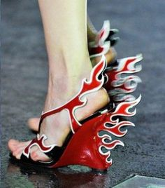 Hot Rod Flaming Shoes are all the talk after Prada started its Spring/Summer 2012 footwear collection campaign. The Hot Rod Flaming Shoes were inspired by American racing cars so popular in the 1950s.