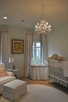 Classic & elegant nursery. Love the chandelier!
