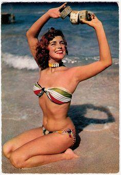Wonderfully vibrant 1950s bathing suit stripes. #beach #vintage #1950s #bikini #summer #model
