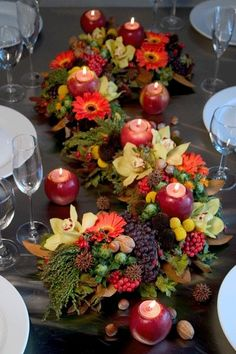Colorful harvest centerpiece dotted with apple votives