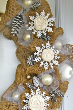 Elegant burlap and snowflake wreath, decorated with dollar store items and rolled flowers