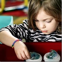 Creative sensory play with ice balls - great for pretend play, and scientific exploration!