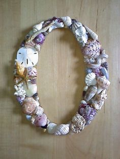 Seashell craft... I wanna do this for my bathroom!