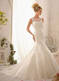 Love this shape. Lace mermaid wedding dress. I like this without the mesh at the top.  For Lexi