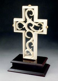 The Unity Cross is a unique way to celebrate the joining of a bride and groom together as one. This multi-piece sculpture is to be assembled during the unity service of the wedding ceremony, representing the joining of two into one. The groom places the outer cross in the wood base. The bride then places the sculpted cross inside the outer cross. The Unity Cross can be displayed in the couple's home after the wedding ceremony as a reminder of their wedding day and the union they ...