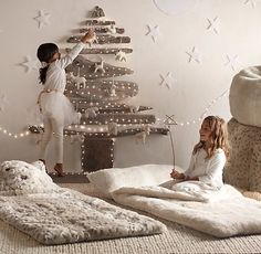 from Restoration Hardware Baby HOliday Collection. Starry String Lights-Tiny lights add a magical glow wherever they're displayed. The ideal illumination for everything from play tents to bed canopies to traditional holiday décor, ours are strung on fine bendable silver wire that conforms to any shape.