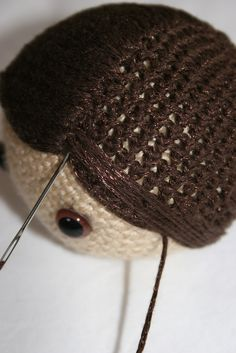Amazing tutorial for adding hair to an amigurumi figure; step by step tutorial.
