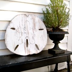 wooden oversized sand dollar beach decoration