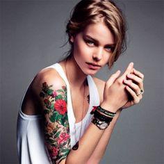 tattoo idea, arm tattoos, sleeve tattoos, vibrant colors, tattoo patterns, a tattoo, tattoo sleeves, flower tattoos, floral tattoos