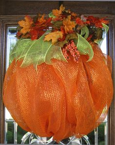 Get ready for Fall, Halloween and Thanksgiving with this beautiful pumpkin! It is made of deco mesh and measures 25x23 and is accented with green mesh ribbon and colorful leaves!