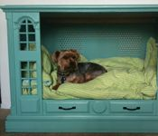 Isn't it great when we can take something we have no longer use for & can turn it into a useful article again.  Sara Allerman did just that.  She took an old TV pulled the TV out but kept the piece of furniture and made it into a bed for our furry friend.  Isn't that so clever.