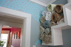 no linen closet, no problem. display your towels with pride - could be a good way of using the space above the stairs