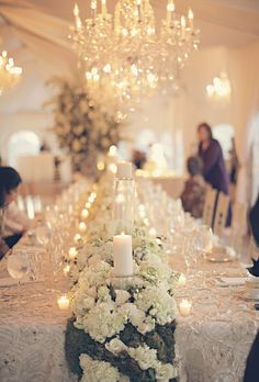 A dreamy reception calls for tons of candles and moss-and-hydrangea table runners