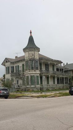 Early 1900's house abandoned on a street corner. Galveston, Texas.