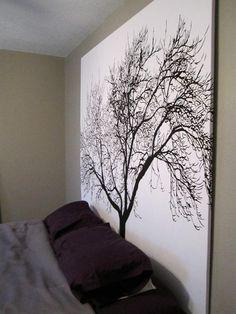 Shower curtain + wood frame = stylish headboard/wall art.