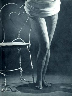 Model in fishnet stockings photographed by Edward Canby for L'almanach Prisma n°5, 1952.