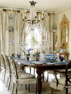 Just perfect. So much here to love, the chandlier, the blue and white, the classic table, perfection