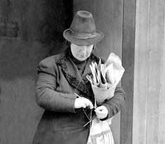 She knits for the troops while selling papers - 18-March-1941. Mrs. Emily Lawrence of Islington, London, known to all as Emily, has been selling newspapers at the Aldwych tube pitch for the last 14 years, and now she has added knitting to her activities. She knits at every odd moment while selling her papers, and so far the troops have two pairs of socks a week and pullovers, Emily's regular output. (Photo by Planet News Archive/SSPL/Getty Images)