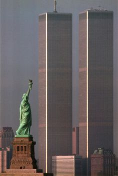 This always will make my heart hurt and ache for those lost.  America Stands Tall    by Adam Woolfitt