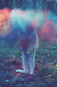 Throwing colored powder in the forest- by British photographer Louis Lander-Deacon