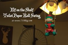 Elf on the Shelf Toilet Paper Roll & Twine Swing The kids like when I give her a nice push so she swings back and forth!   Elf on the Shelf Ideas Easy Elf on the Shelf Poses