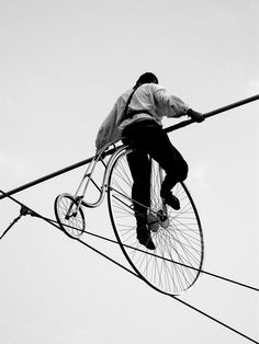 Penny-Farthing on a high-wire .. love this photo