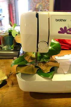 sew together magnolia leaves for garland