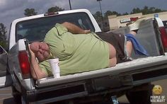 """I don't know what is more distracting to me, the """"belly butt"""" , the Sonic cup or his shoes.  One question though, why is his truck door open?"""