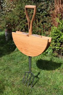 table made from pitchfork. great for uneven outdoor ground