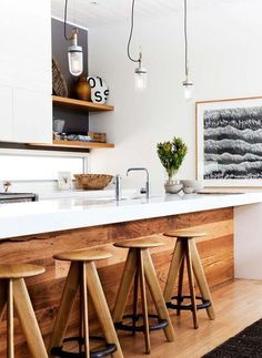18. Wood Stools and Island Siding Add a good dose of wooden charm to your rather plain and modern kitchen. Warm wood panels and wooden bar stools are all you need to lift up an ordinary kitchen.