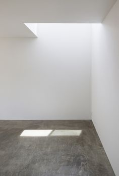 Concrete floor with plaster walls. KDR House by I.R.A.