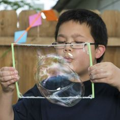 Turn your backyard into a summer science carnival with fun, hands-on experiments from MSI, like these super bouncy bubbles.