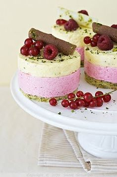 Pretty enough to serve at a wedding: Pistachio, Lemon and Berry Mini Cheesecakes. #food #dessert #cheesecake #currants #raspberries #lemon #pistachio