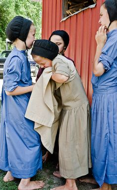 Amish girls supporting a friend