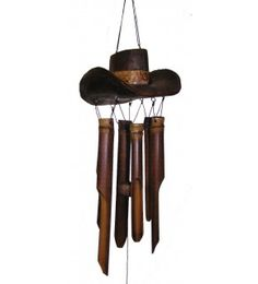 """Handcrafted by Balinese artists, this fun wind chime features a Cowboy Hat, hand-carved from coconut wood, atop bamboo tubes. The hat has a wide brim and a dark brown finish. It's perfect for any """"cowboy"""" or """"cowgirl!"""" Eco-friendly bamboo tubes create a relaxing, mellow sound. Each wind chime is hand tuned and made from the highest quality materials."""