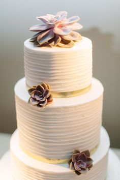 Wedding cake with gold and succulent details: http://www.stylemepretty.com/2014/10/18/spring-downtown-dallas-loft-wedding/ | Photography: Apryl Ann - http://aprylann.com/