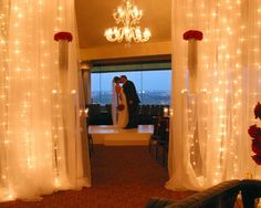Ceremony backdrop - draping with twinkle lighting
