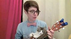 A kitten learning how to play the ukulele, a.k.a. best thing we've seen all week.