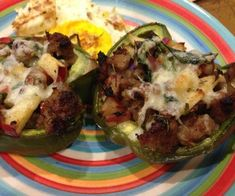 A great egg-free paleo breakfast.  A sweet and savory mixture of sauteed spinach, apples and breakfast sausage stuffed into roasted bell peppers. Add cheese to make it primal style!