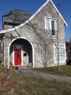 Grey house, white trim, red door