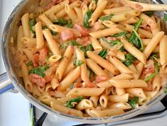 Creamy Tomato and Spinach Pasta Recipe  1 Tbsp olive oil 1 small onion 2 cloves garlic 1 (15 oz.) can diced tomatoes ½ tsp dried oregano ½ tsp dried basil pinch red pepper flakes (optional) freshly cracked pepper to taste ½ tsp salt 2 Tbsp tomato paste 2 oz. cream cheese ¼ cup grated Parmesan ½ lb. penne pasta ½ (9 oz.) bag fresh spinach