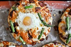 Pizza for breakfast: bacon, egg, and asparagus personal pizzas