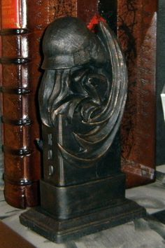 Cthulhu EOD Pillar: Outside the entrance to the Esoteric Order of Dagon in Innsmouth, it is said there are two hideous pillars topped with a depiction of a dreadful thing...