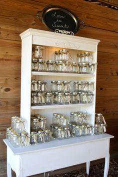 Have a bunch of mason jars and a candy bar and allow the guests to fill up the jars