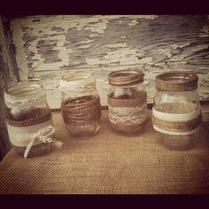 We could make these!!!! 4 Burlap and Lace Mason Jar Set Wedding Bridal Shower Country Home Decor Twine Mason Jars Burlap Mason Jars Lace Mason Jars. $28.00, via Etsy.