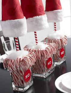 Red felt and fake fur hat, barber pole dowel, square vase stuffed wtih candy canes and 'snow fluff' ... too Santaesque not to love.