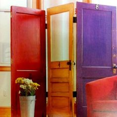 3 reused doors connected by their hinges  painted in colors you like...and voila, you have a room divider!